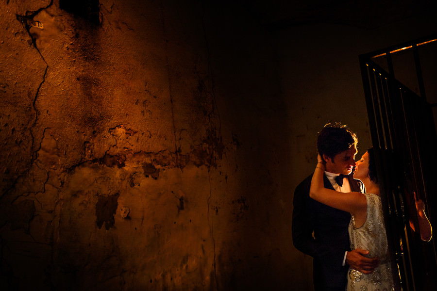 Bride and groom kiss at Charleston Old City Jail.