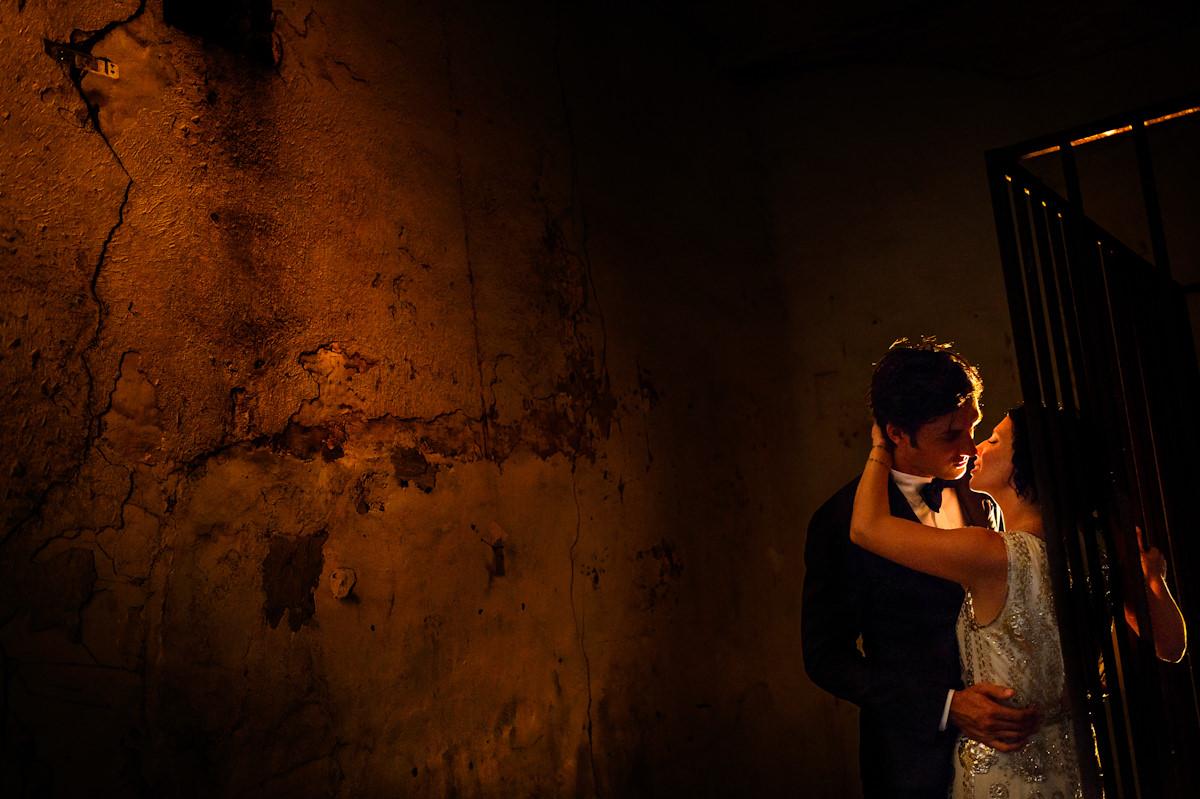 Bride and groom kiss at Charleston Old City Jail.
