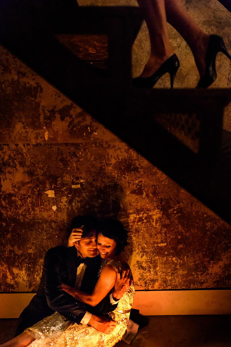 Bride and groom under strairway at Old City Jail.