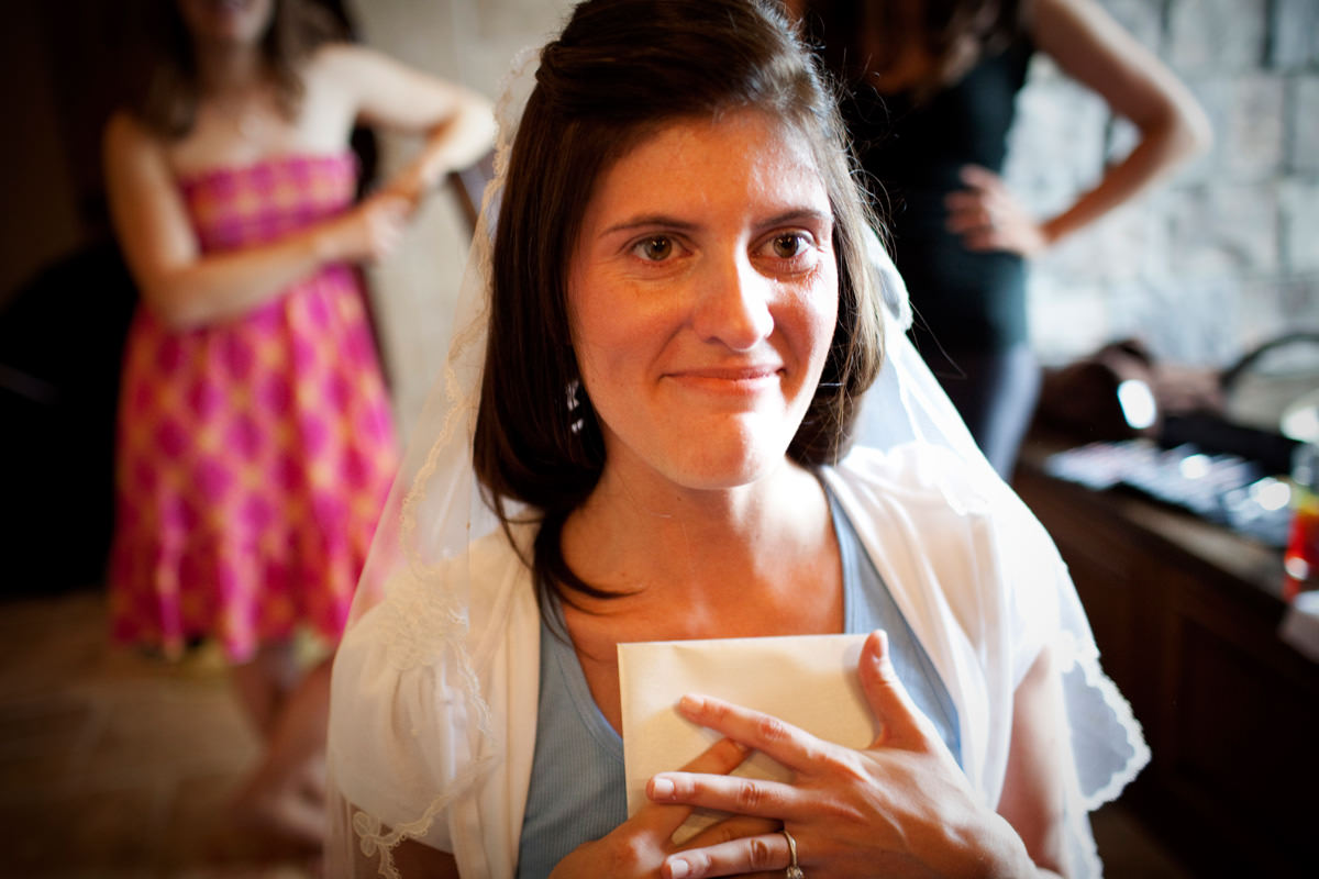 Portrait of bride as she gets ready