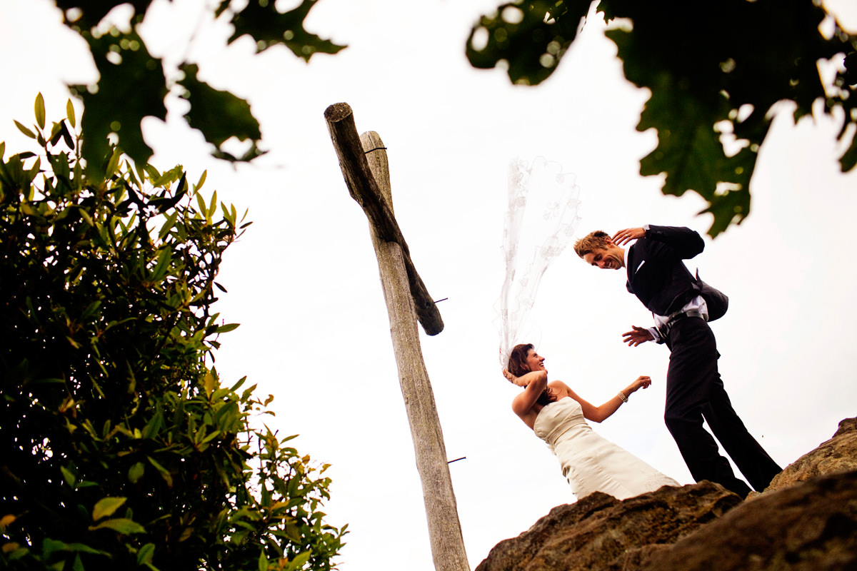 Wind sweeps bride's veil in the air