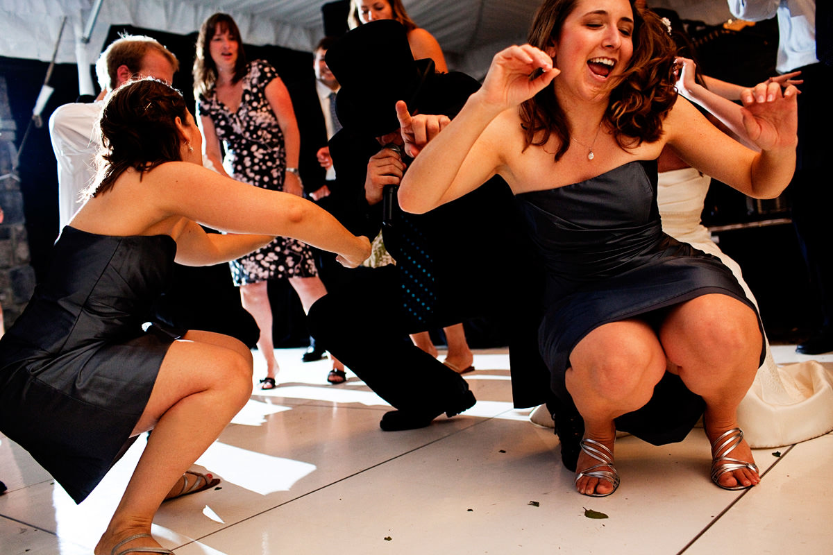 Wedding guests dance at wedding reception