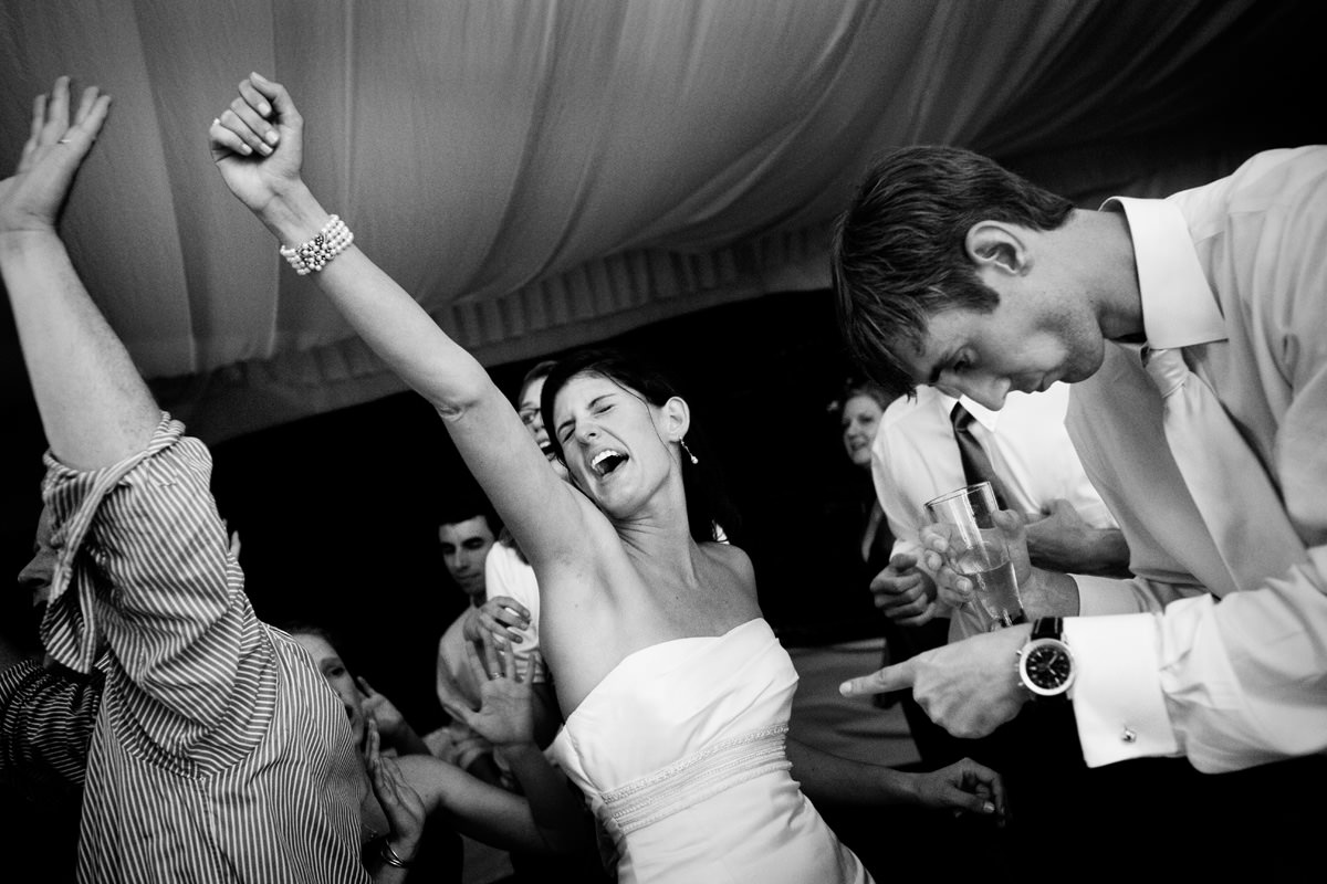 Bride and bridegroom dance with wedding guests at North Carolina wedding