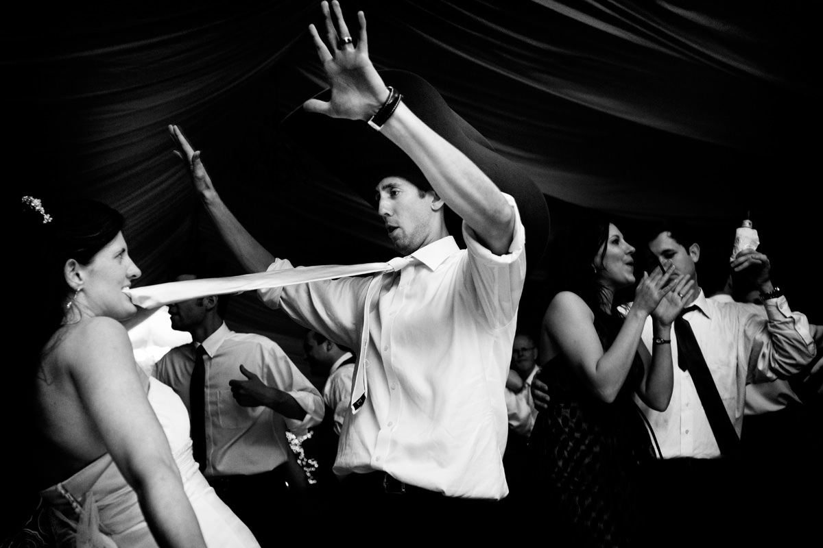 Bride and bridegroom have fun on the dancefloor