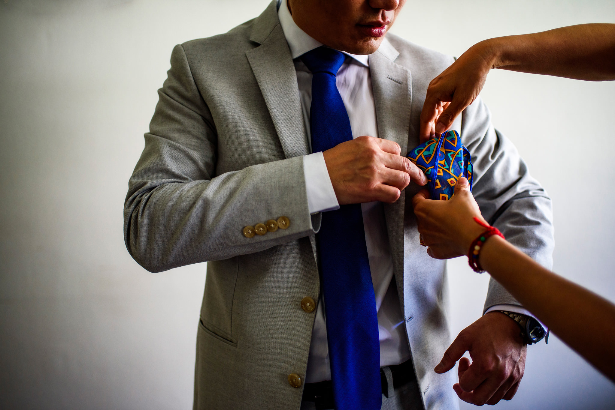 Groom gets flowers for his jacket
