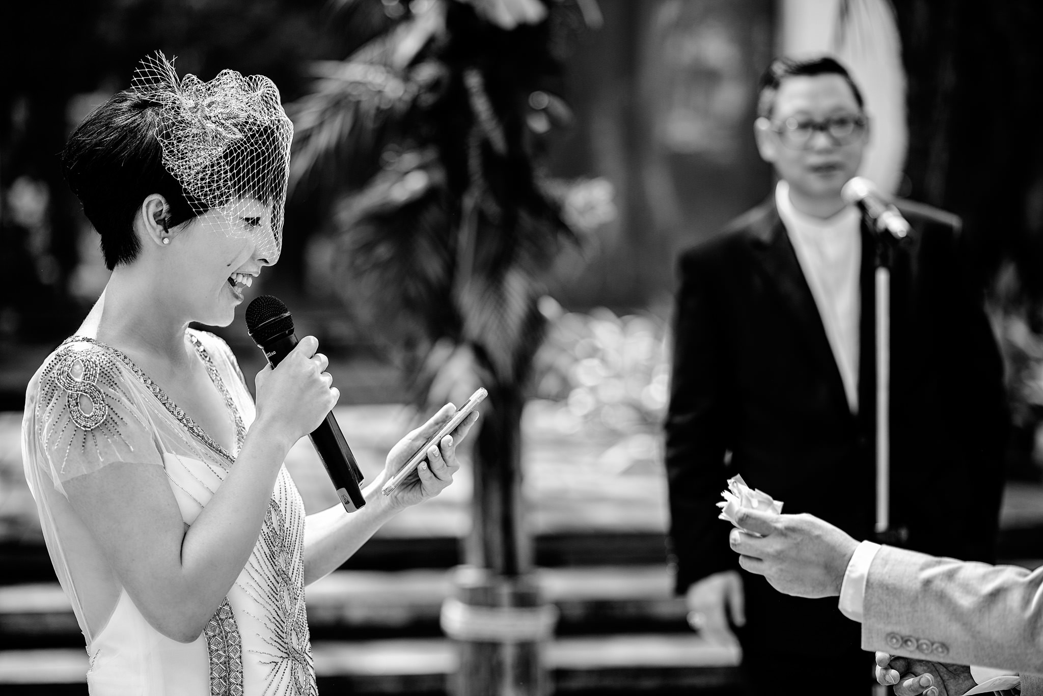 Groom offers tissue to crying bride