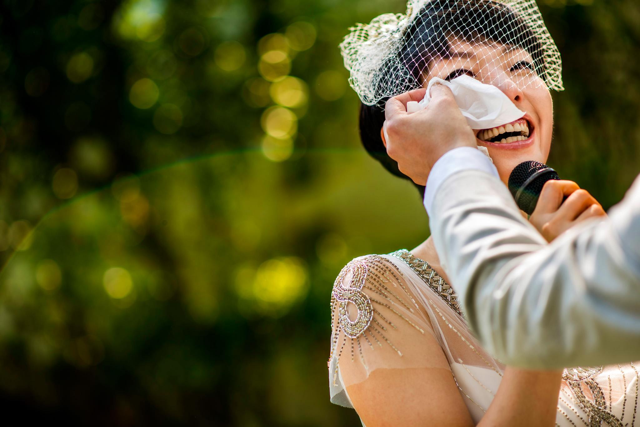 Groom wipes bride's tear
