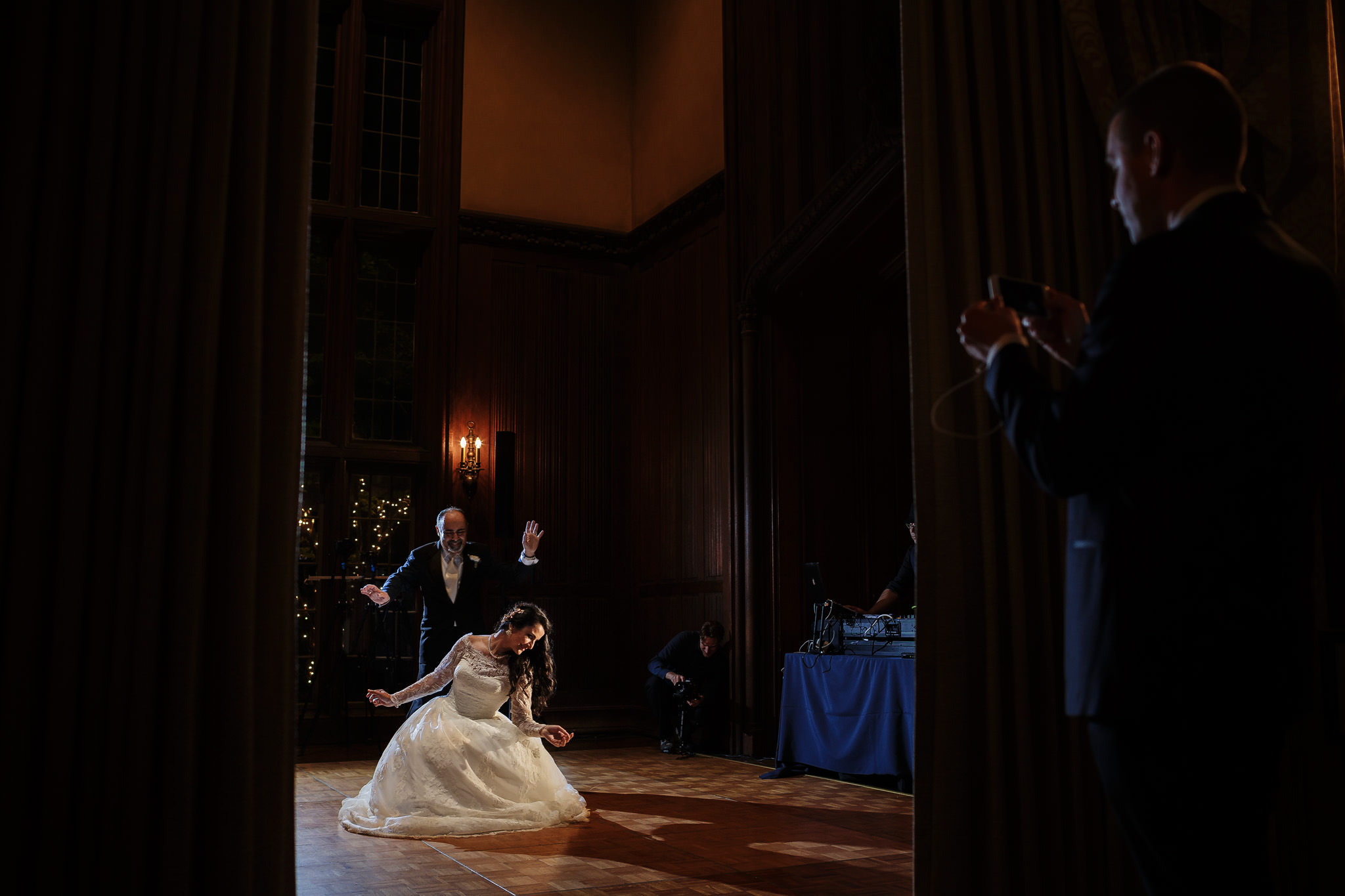 Bride dances at wedding reception Kohl Mansion in Burlingame