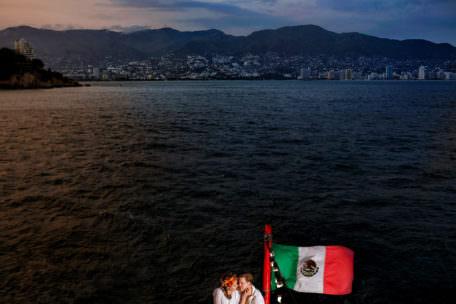 Bride and bridegroom on a boat ride in Acapulco, Mexico