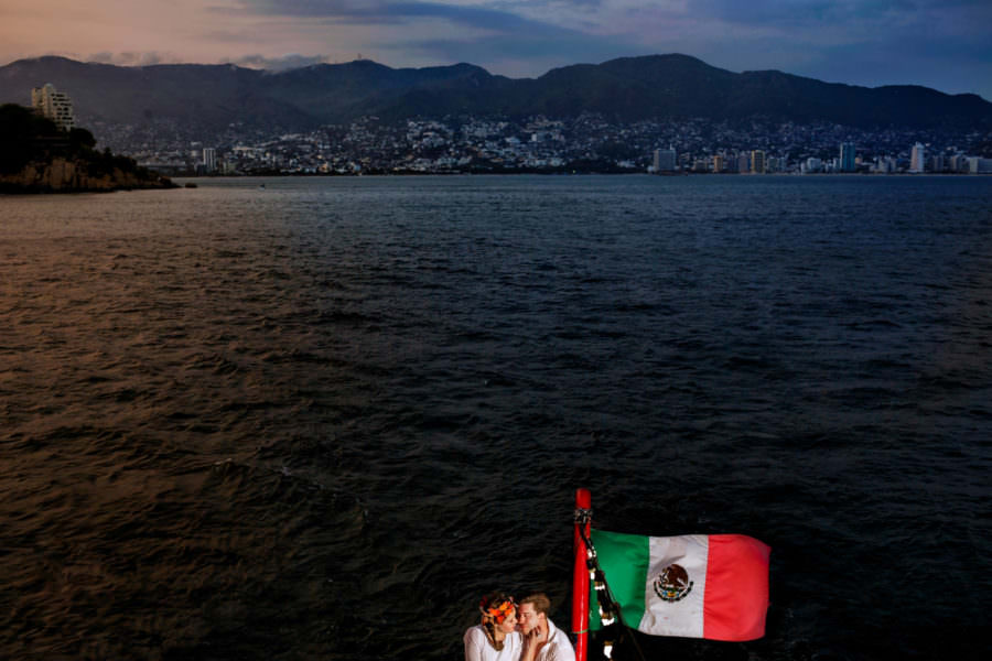 Bride and bridegroom on a boat ride in Acapulco, Mexico