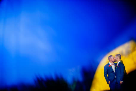 Unique portrait of gay couple at their wedding in Charleston