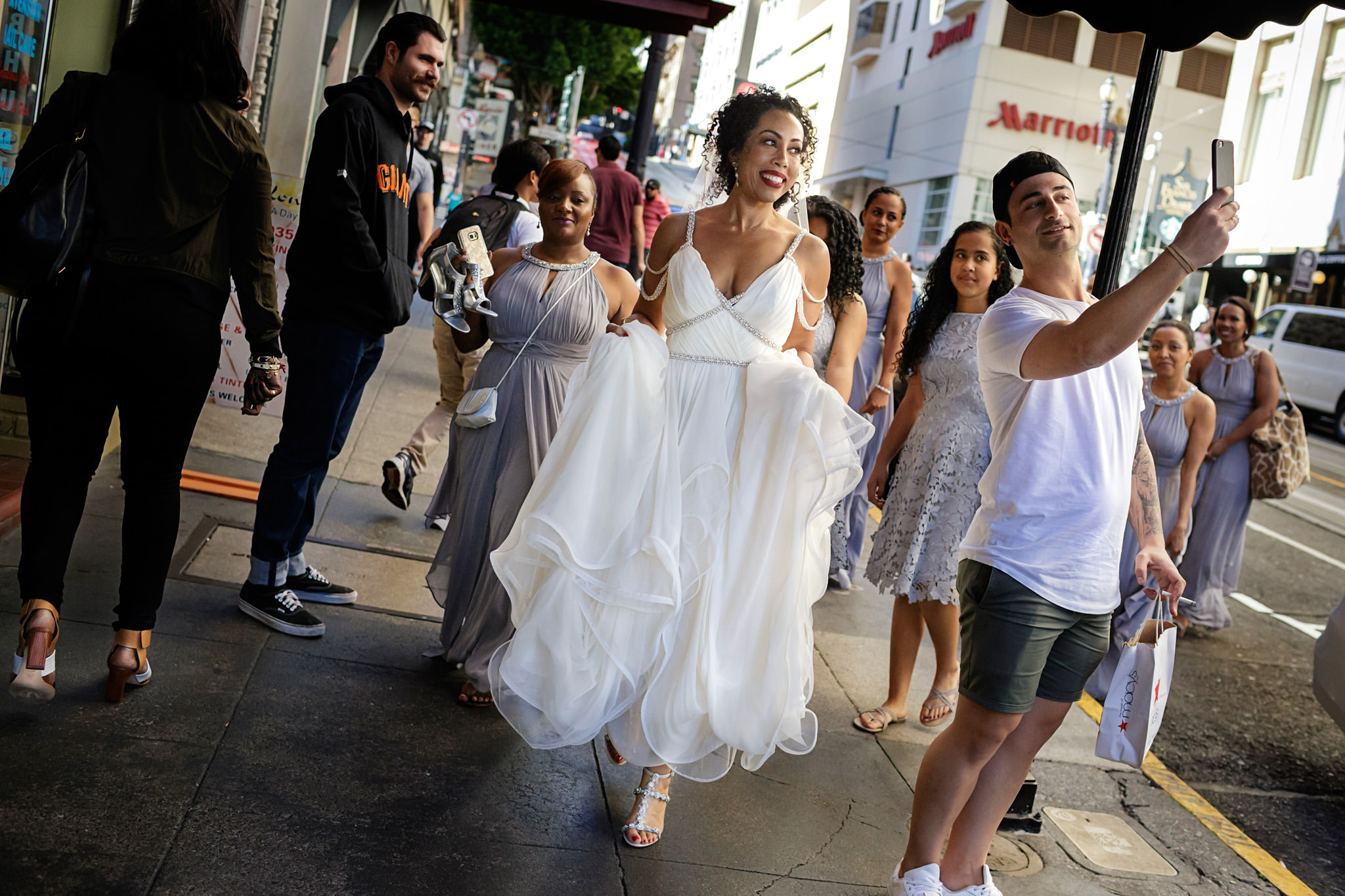 Bride and her bridal party in the street in San Francisco, California