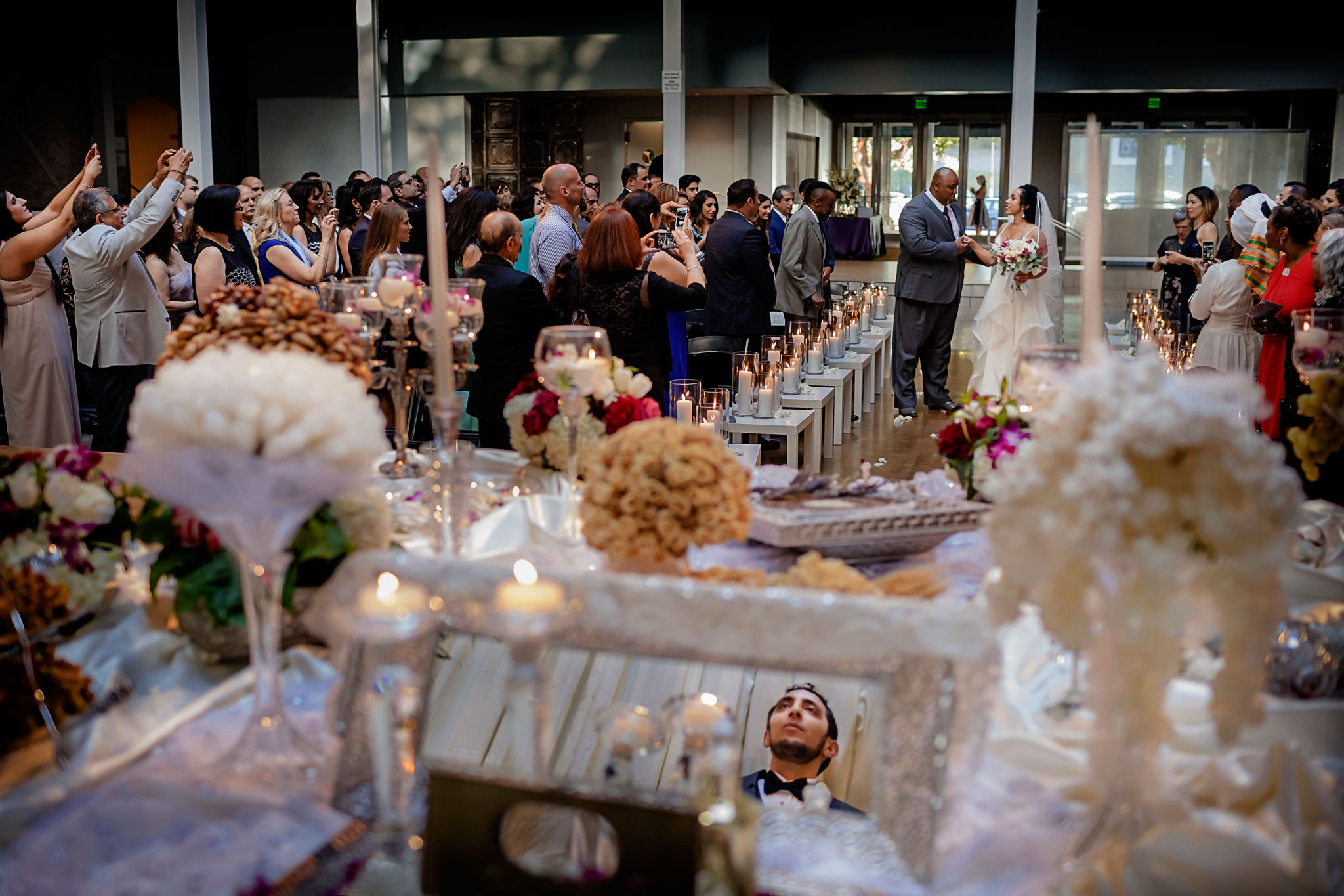 Father of the bride walks bride down the aisle at at the San Francisco Design Center in California