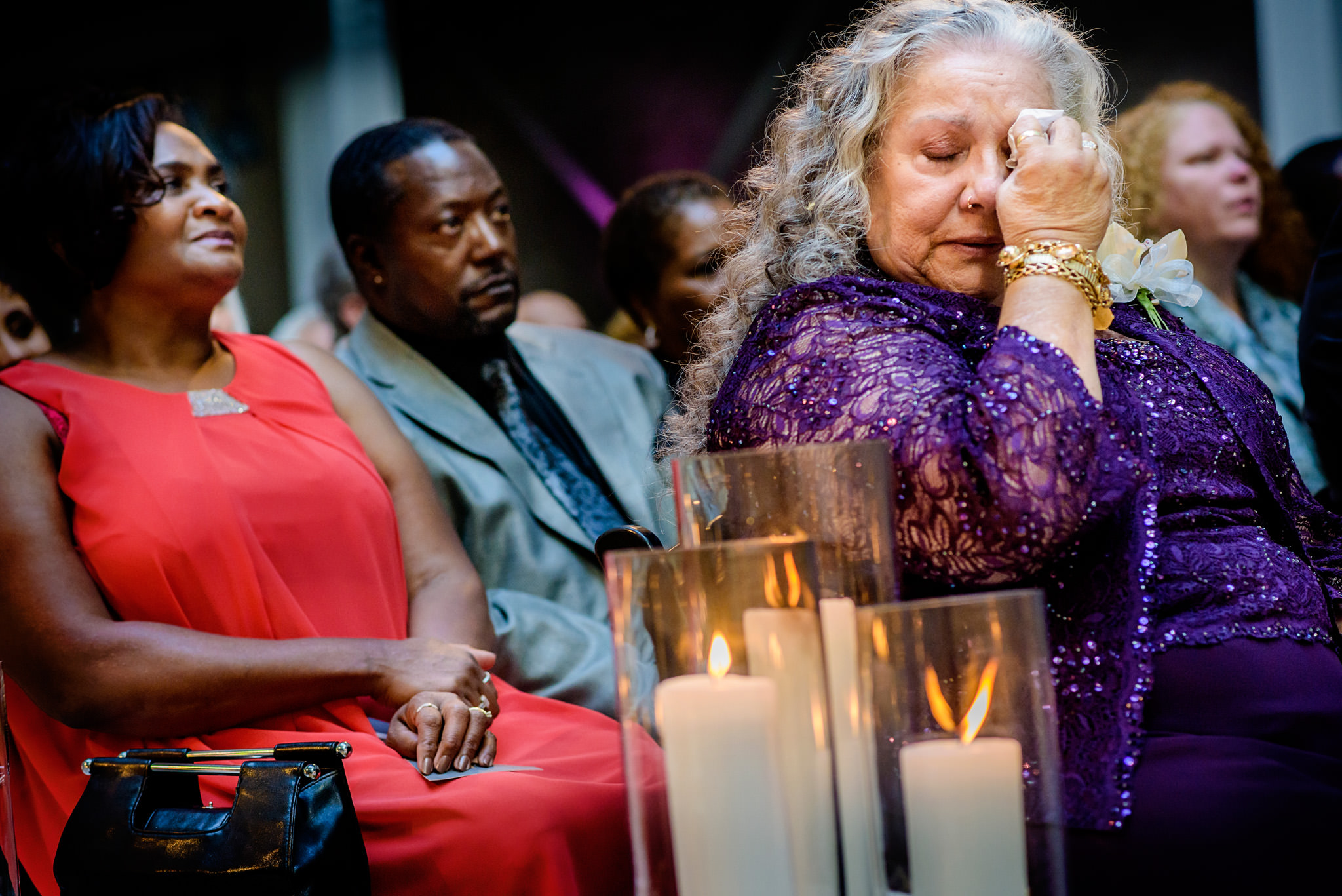 A wedding guest displays emotion during the wedding ceremony