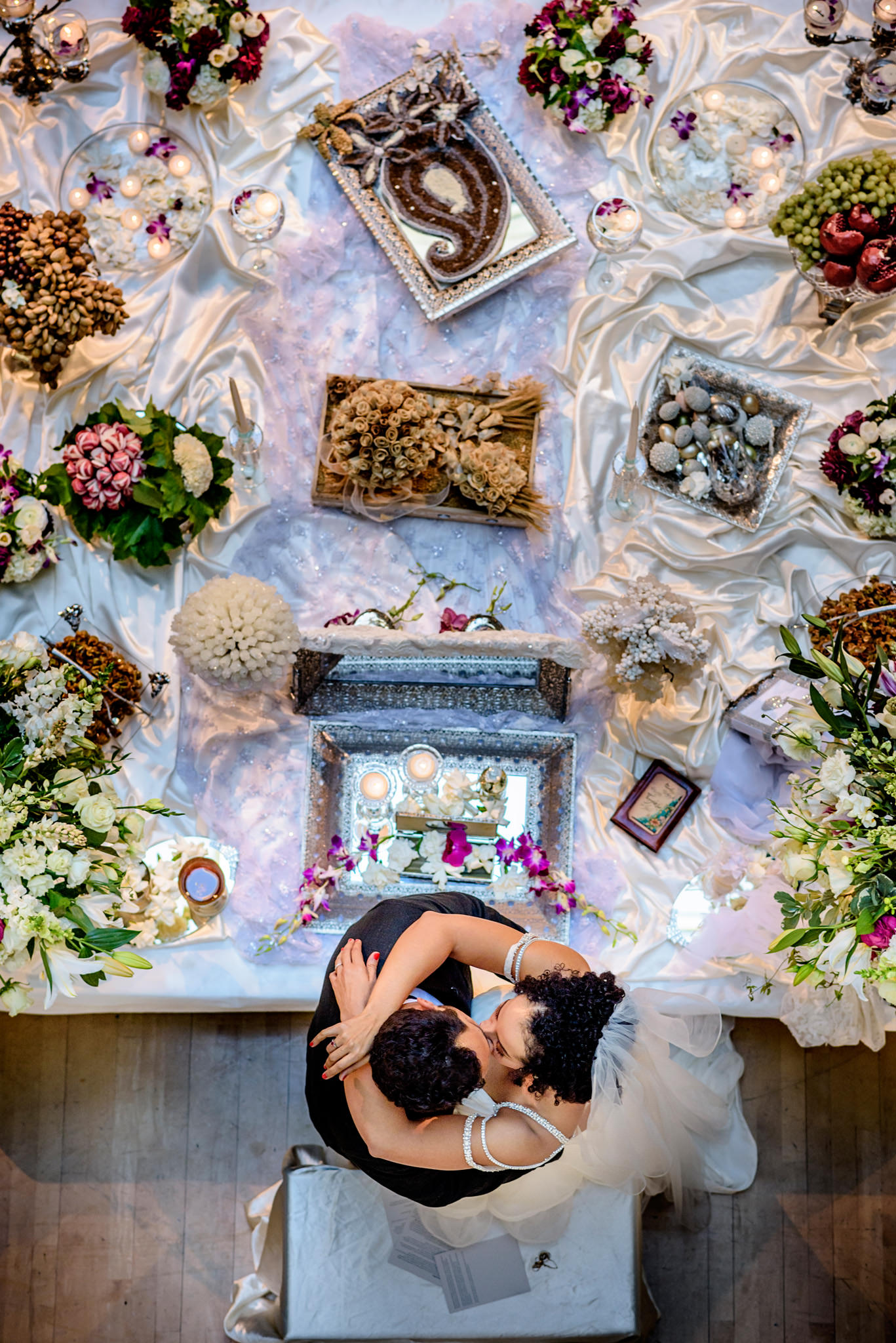 Bride and bridegroom share their first kiss at Persian wedding in California