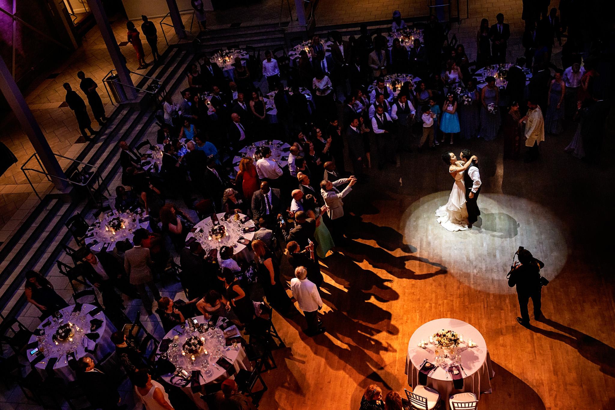 Bride and bridegroom open the dancefloor at their wedding reception in San Francisco, California