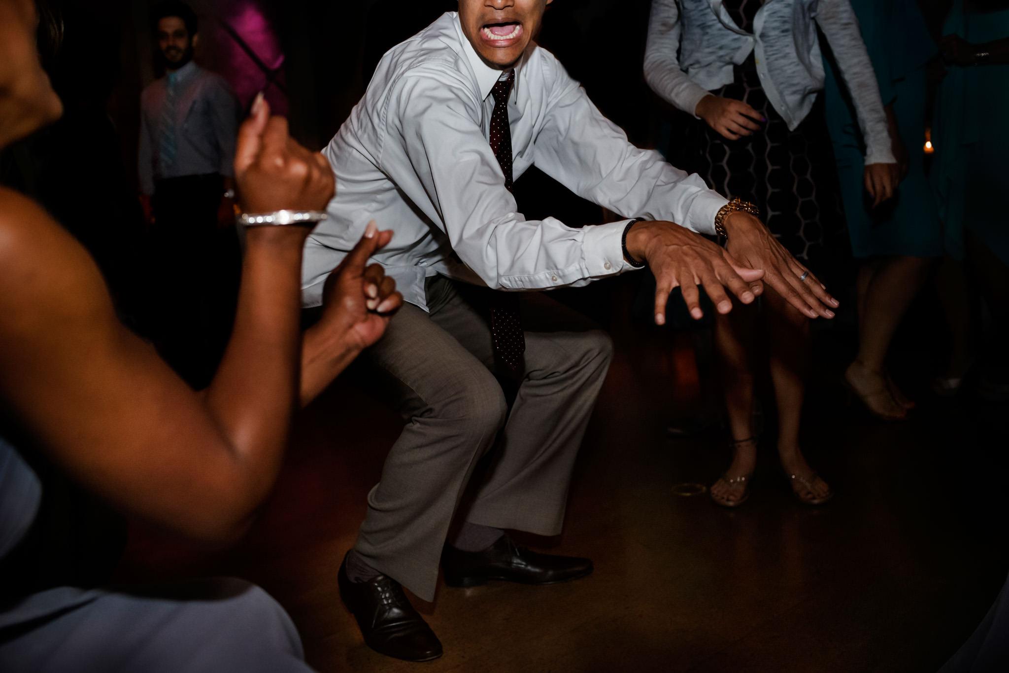 Wedding guests dance at wedding reception in San Francisco