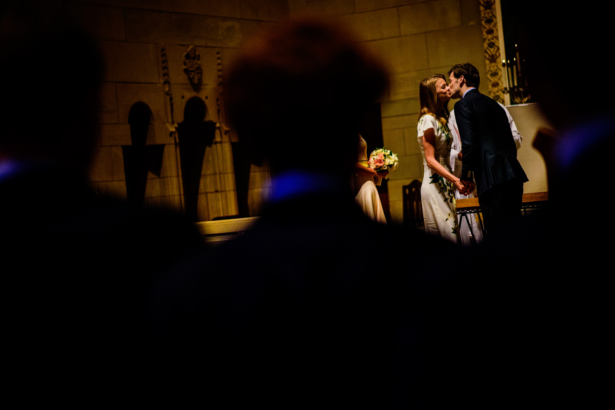 Bride and bridegroom share their first kiss