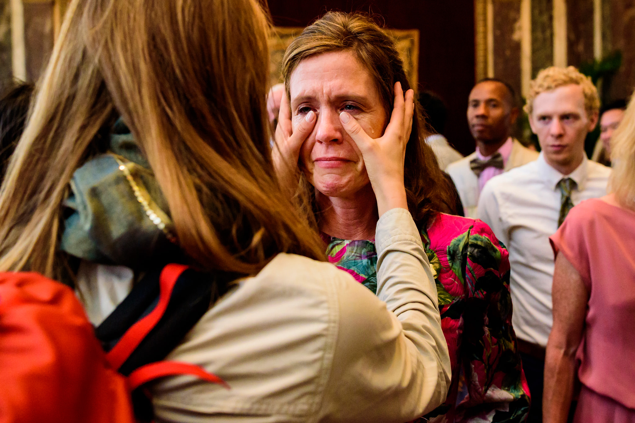 Bride wipes away mother's tears before leaving on honeymoon